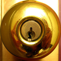 a close up image of a brass doorknob | denver emergency locksmith